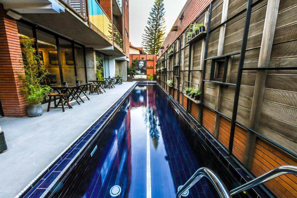 The swimming pool at or near Alfonsina Hotel Boutique
