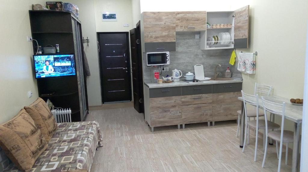 Кухня или мини-кухня в Студия у моря