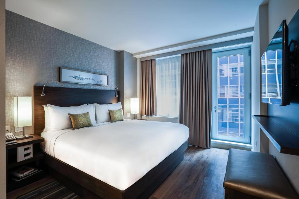A bed or beds in a room at The Bernic Hotel New York City,Tapestry Collection by Hilton