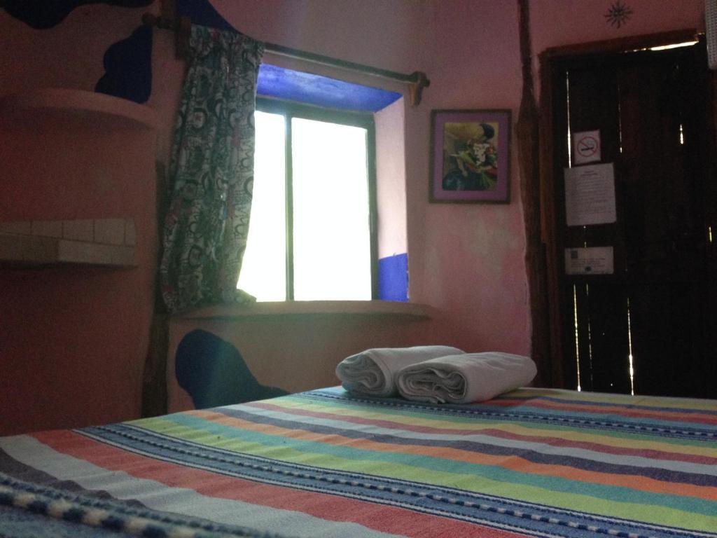 Кровать или кровати в номере Acamaya Reef Cabañas