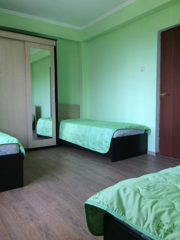 A bed or beds in a room at Uiut Guest house