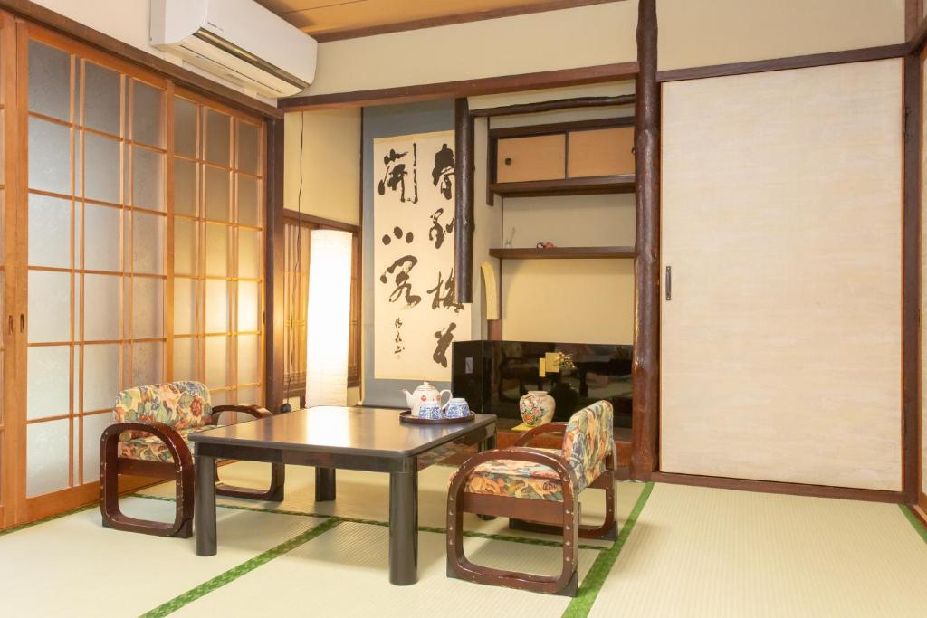 A seating area at Kyoto Aya Guest House