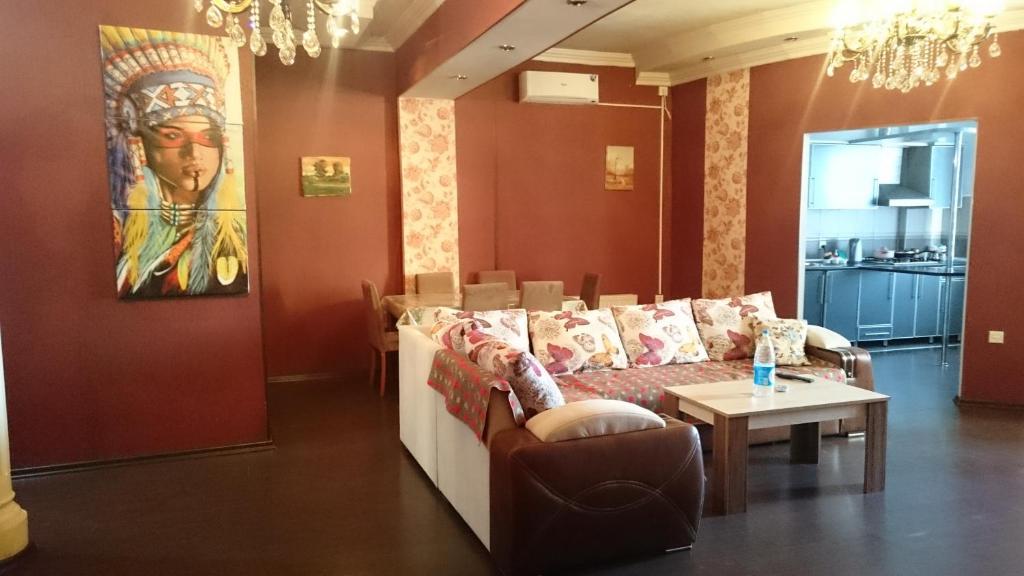 Uma área de estar em Apartment on Xudu Məmmədov 36
