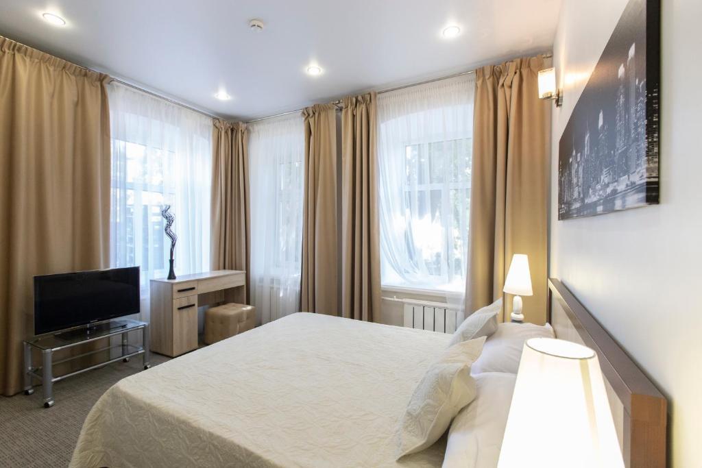 Кровать или кровати в номере Артхофф