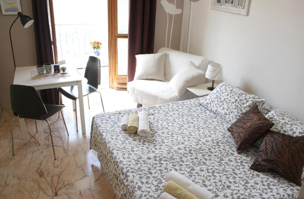 A bed or beds in a room at A Casa Romar