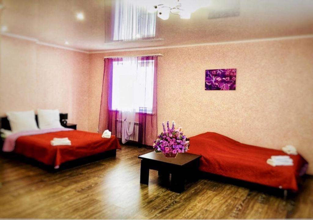 Кровать или кровати в номере Гостевой Дом Дарина в Востряково