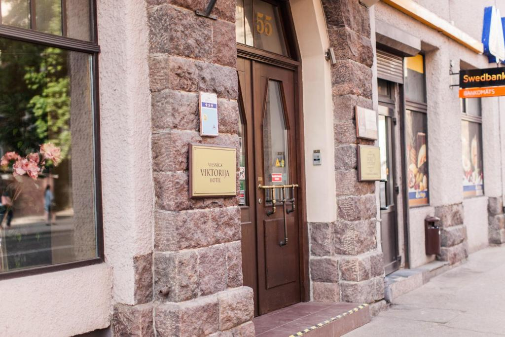 The facade or entrance of Hostel Viktorija with Private Rooms