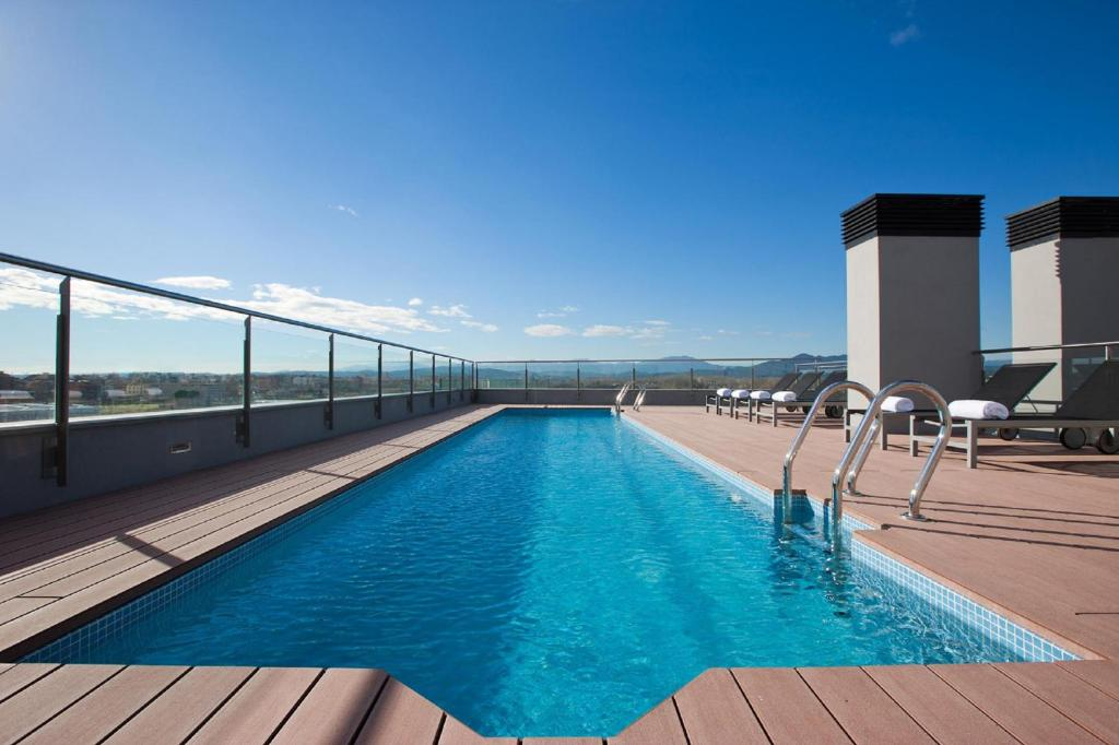 The swimming pool at or near DoubleTree by Hilton Girona