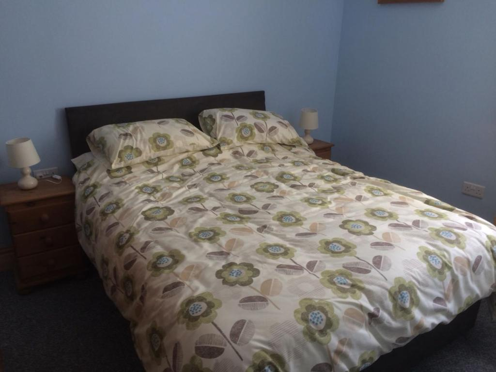 A bed or beds in a room at Brentwood