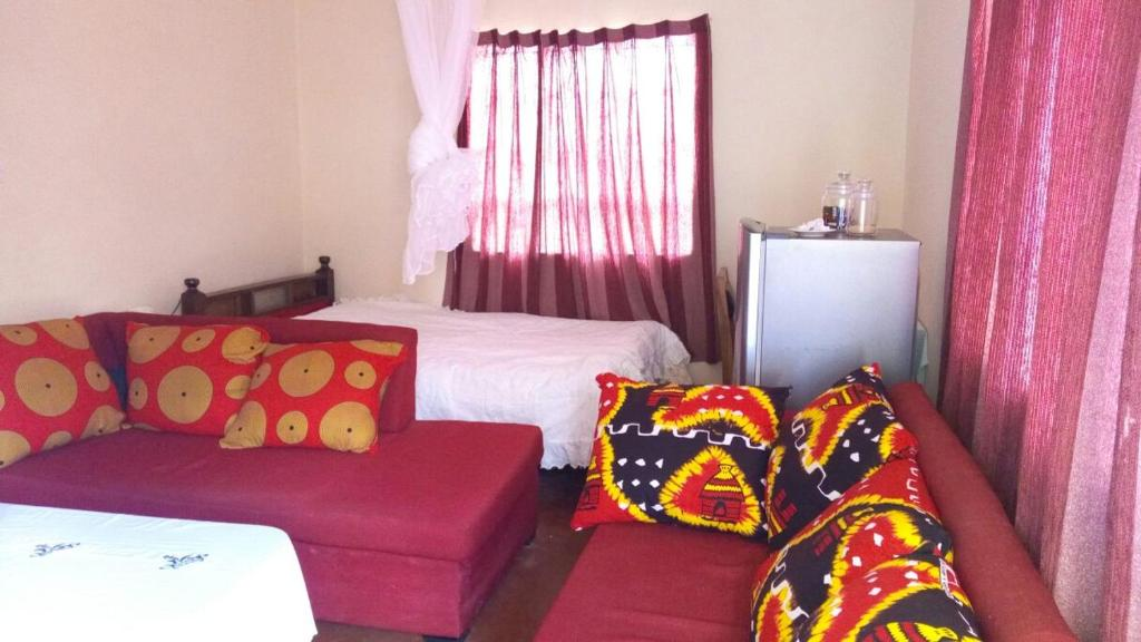 A bed or beds in a room at Happy Valley self Catering Thika.
