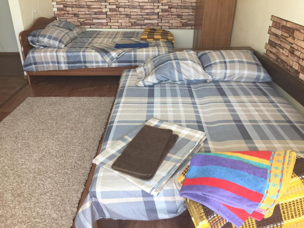 Кровать или кровати в номере Apartment on Libnekhta