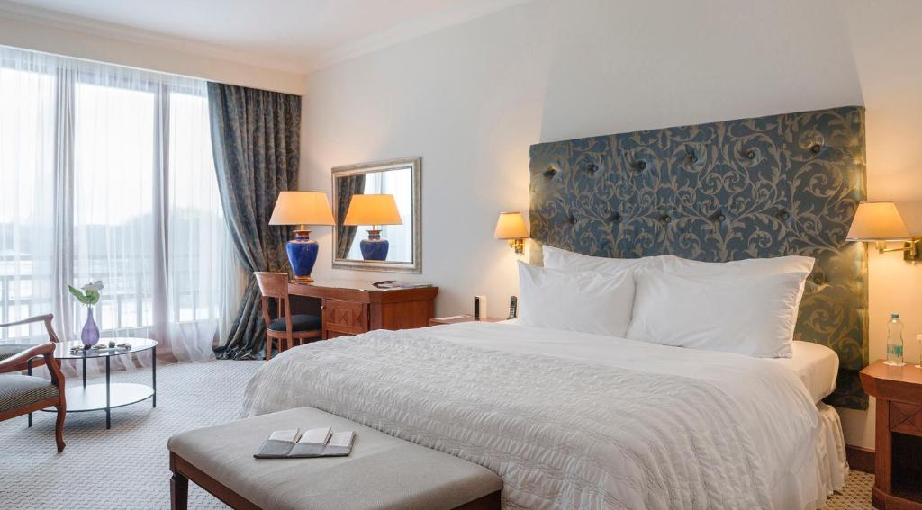 A bed or beds in a room at Vilnius Grand Resort
