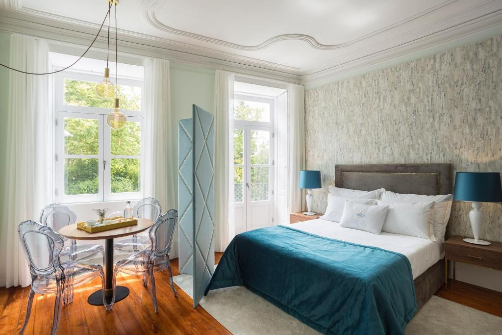 A bed or beds in a room at Predicados do Douro Palace