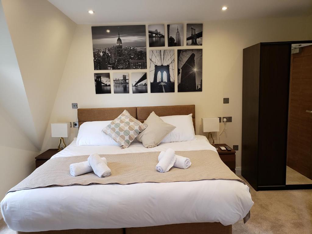 Ein Bett oder Betten in einem Zimmer der Unterkunft London Star Hotel