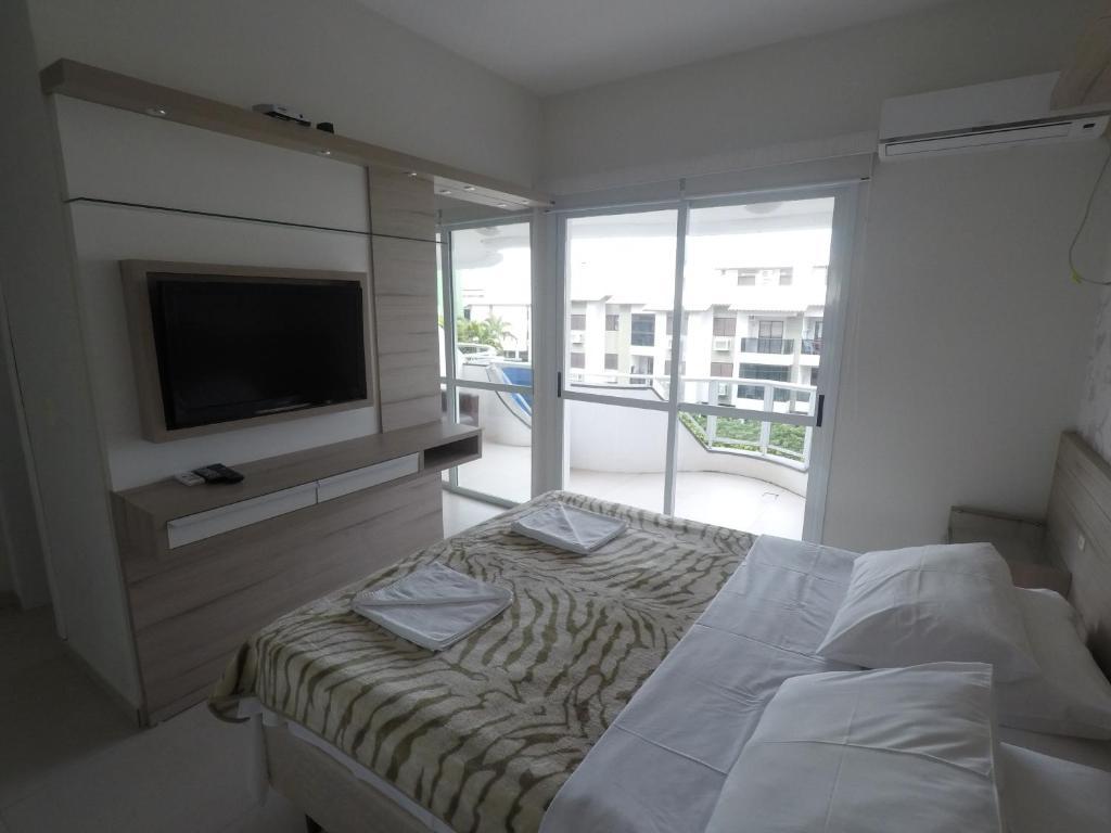 Cama ou camas em um quarto em Apartamentos Férias Florianópolis
