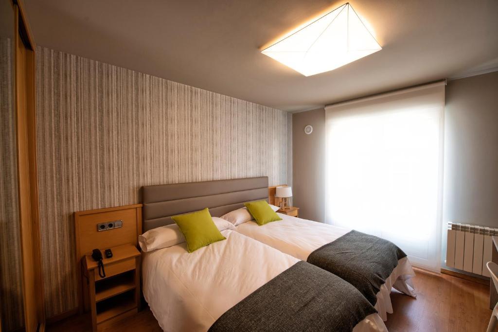 Cama o camas de una habitación en Hotel VIDA Mar de Laxe