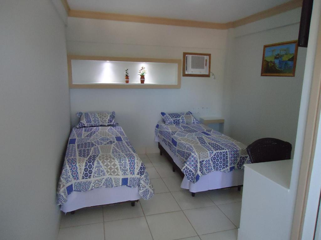 A bed or beds in a room at Hotel Amadeu´s