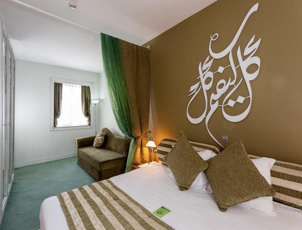 A bed or beds in a room at Adamar Hotel-Special Category