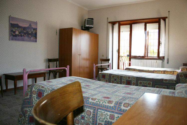 Кровать или кровати в номере Albergo Anna