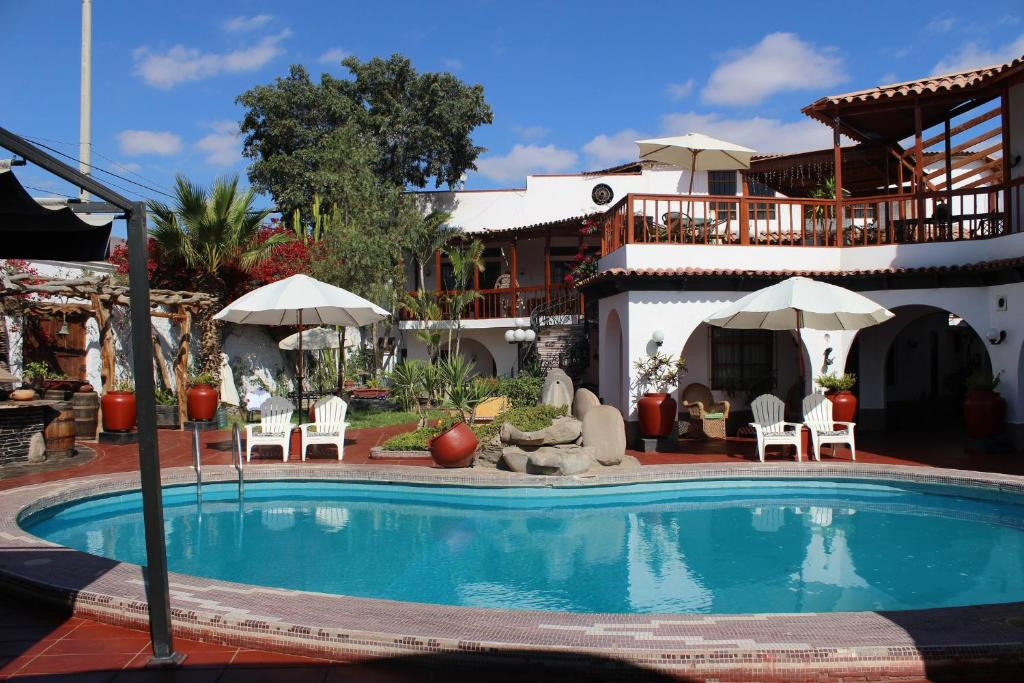 The swimming pool at or close to Hotel Don Agucho
