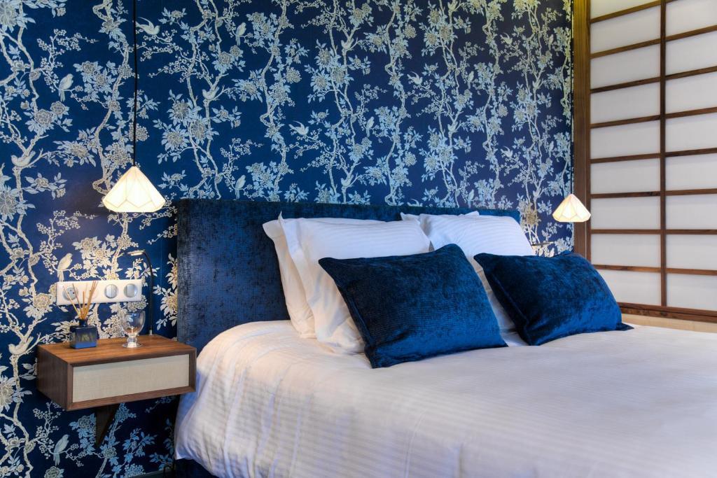 Un ou plusieurs lits dans un hébergement de l'établissement Chambres d'hôtes Domaine de Nazère
