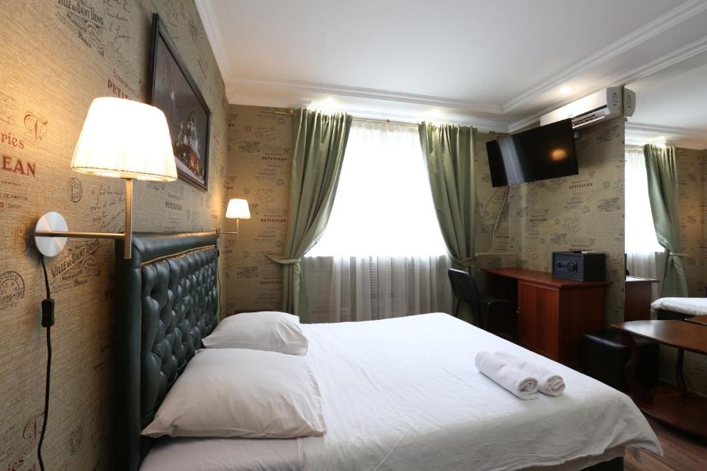 Кровать или кровати в номере Отель Чар на Тульской