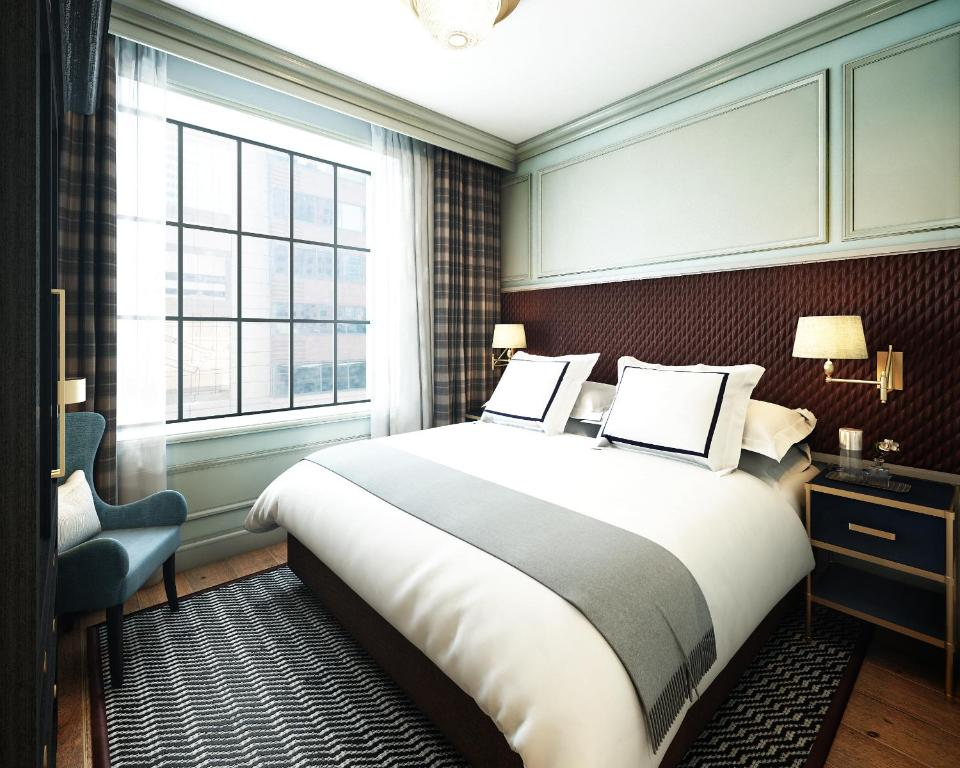 A bed or beds in a room at Merrion Row Hotel and Public House