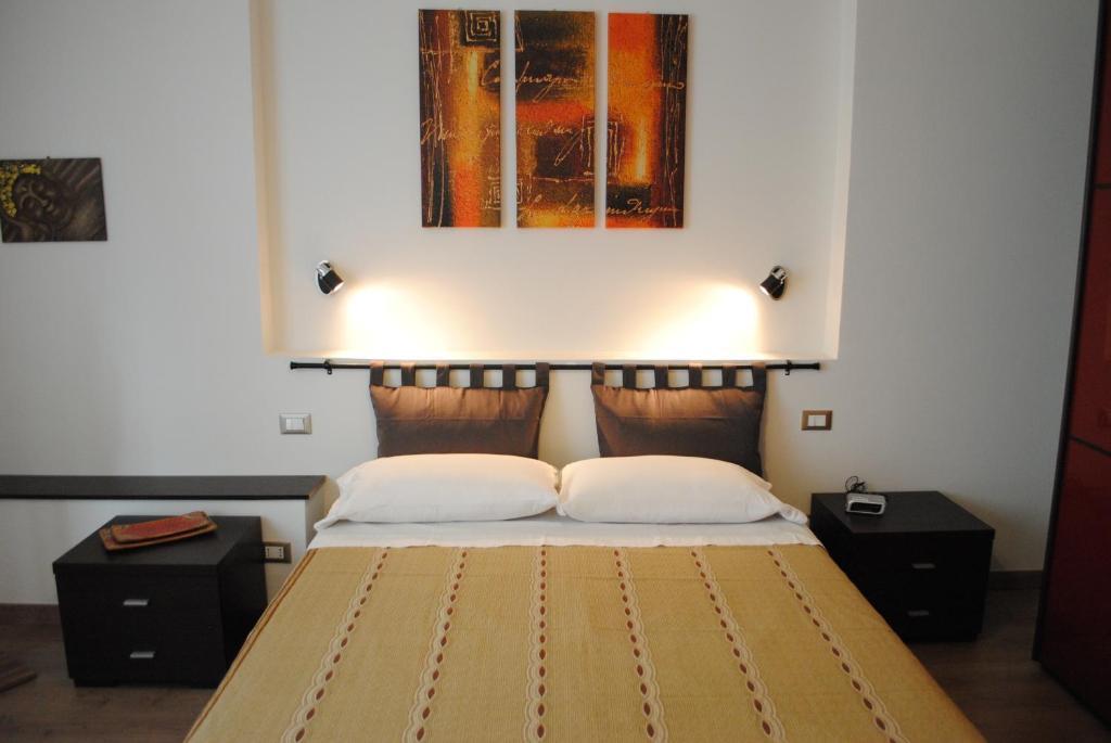 Letto o letti in una camera di Casa Gordigiani di Berti Anna