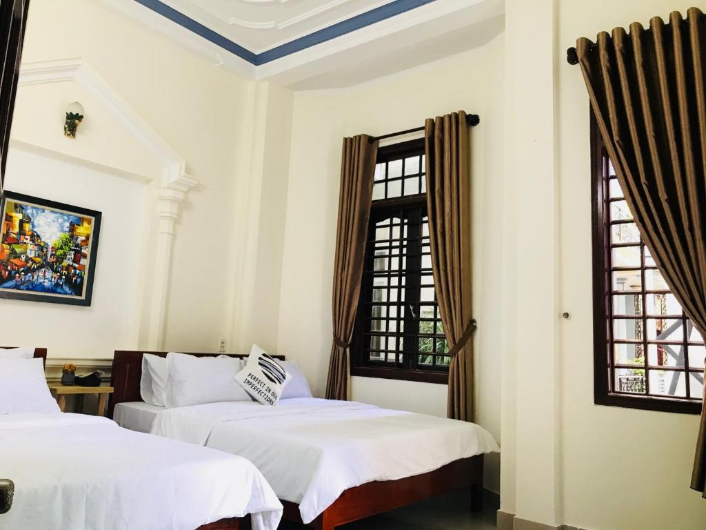 A bed or beds in a room at Eva Homestay