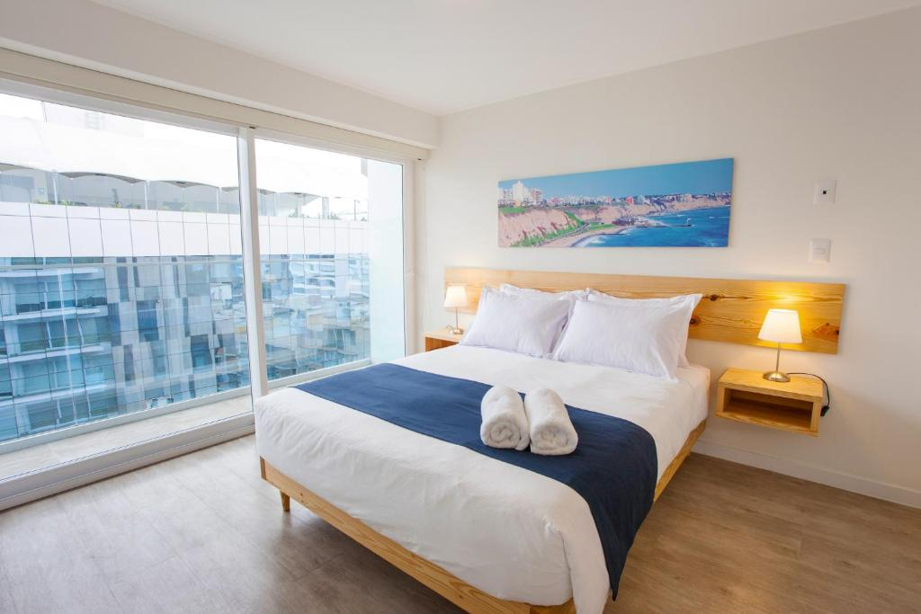 A bed or beds in a room at Lima Walking Apartments - Central Miraflores