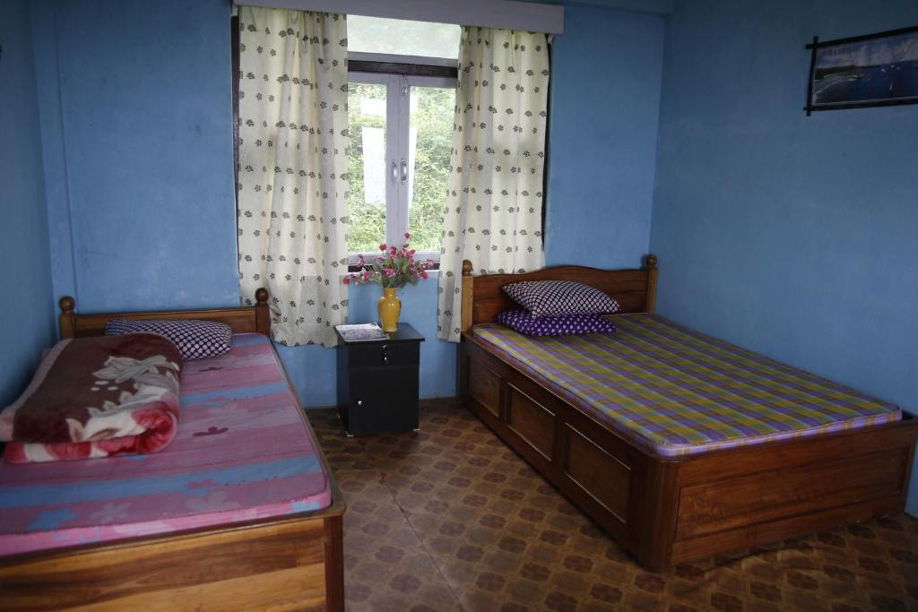 A bed or beds in a room at Vamoosetrail Borong Polok Village