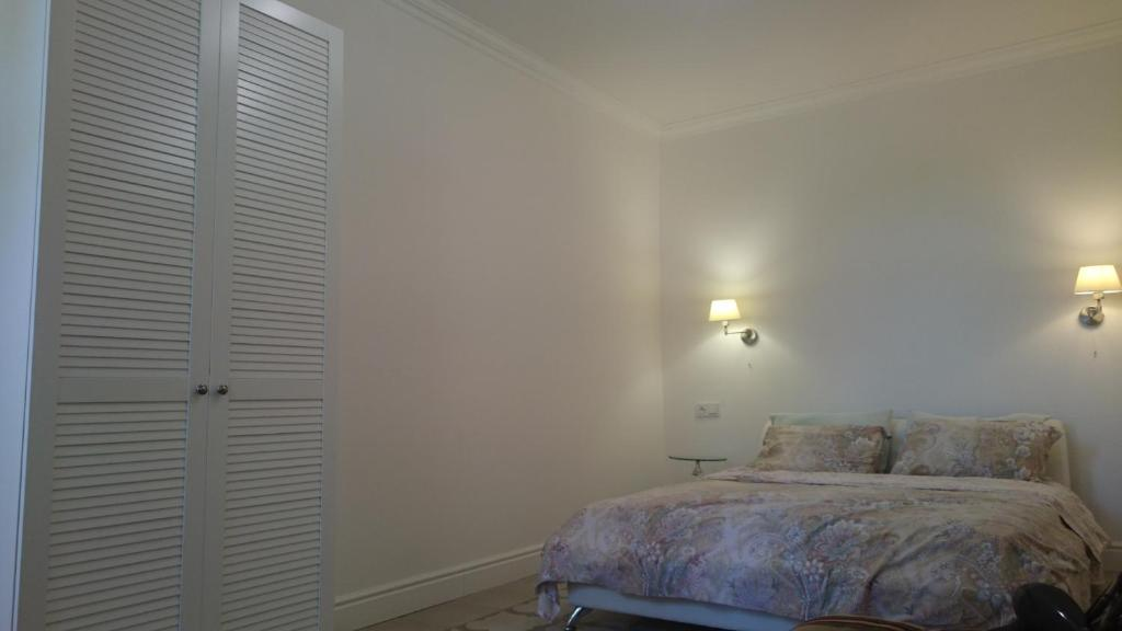 Кровать или кровати в номере YaltaVoyage