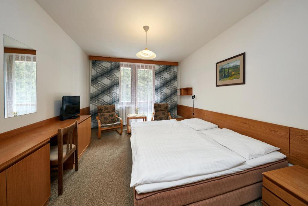 A bed or beds in a room at Apartmany Firn