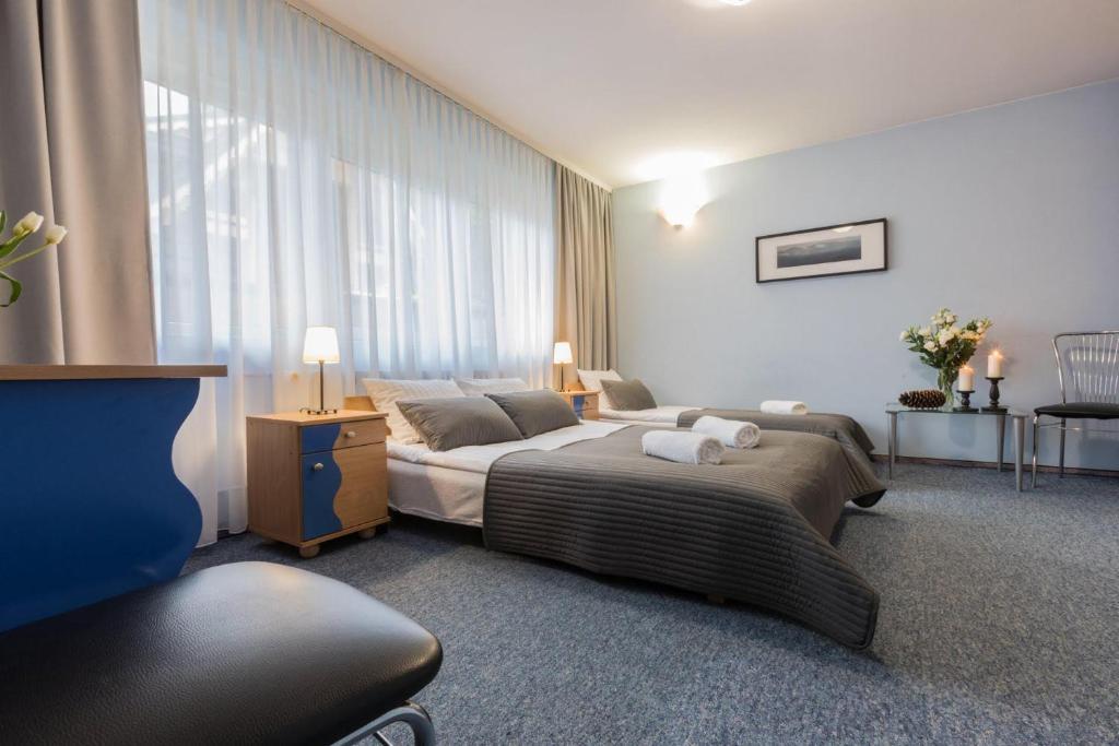 Łóżko lub łóżka w pokoju w obiekcie Liberta INN - Pokoje Gościnne