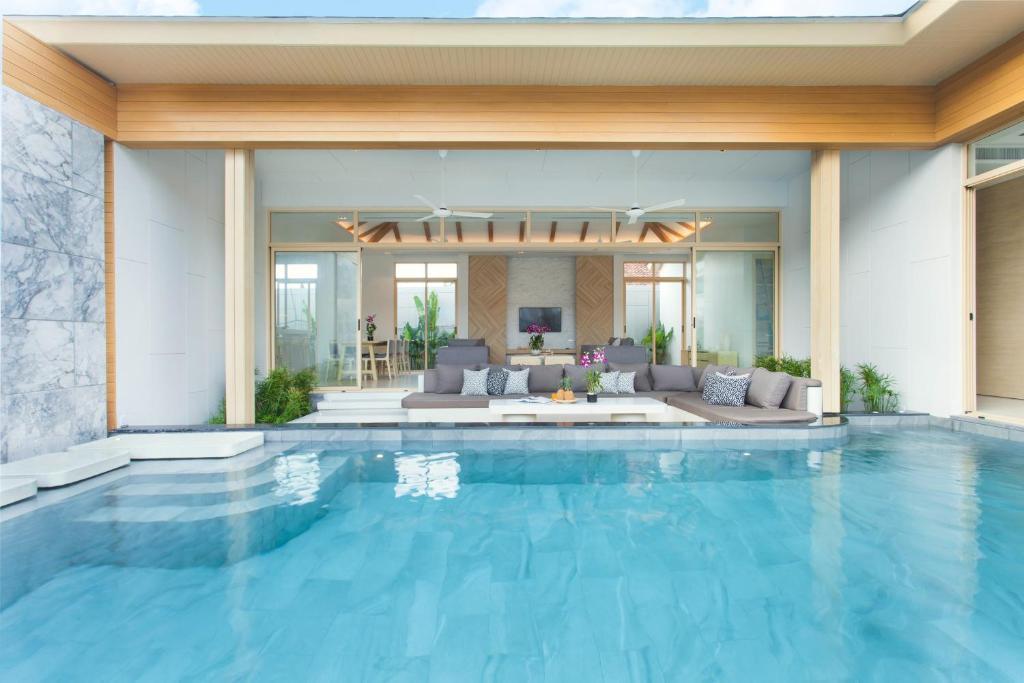 The swimming pool at or near Himmapana Villas