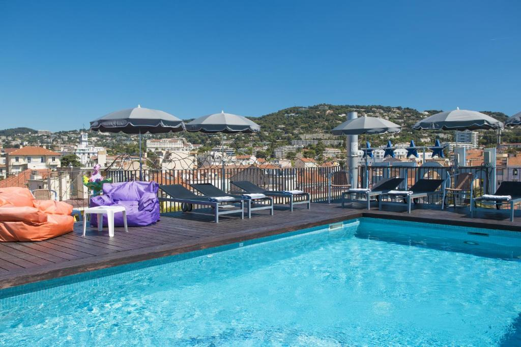 The swimming pool at or near BEST WESTERN PLUS CANNES RIVIERA & SPA