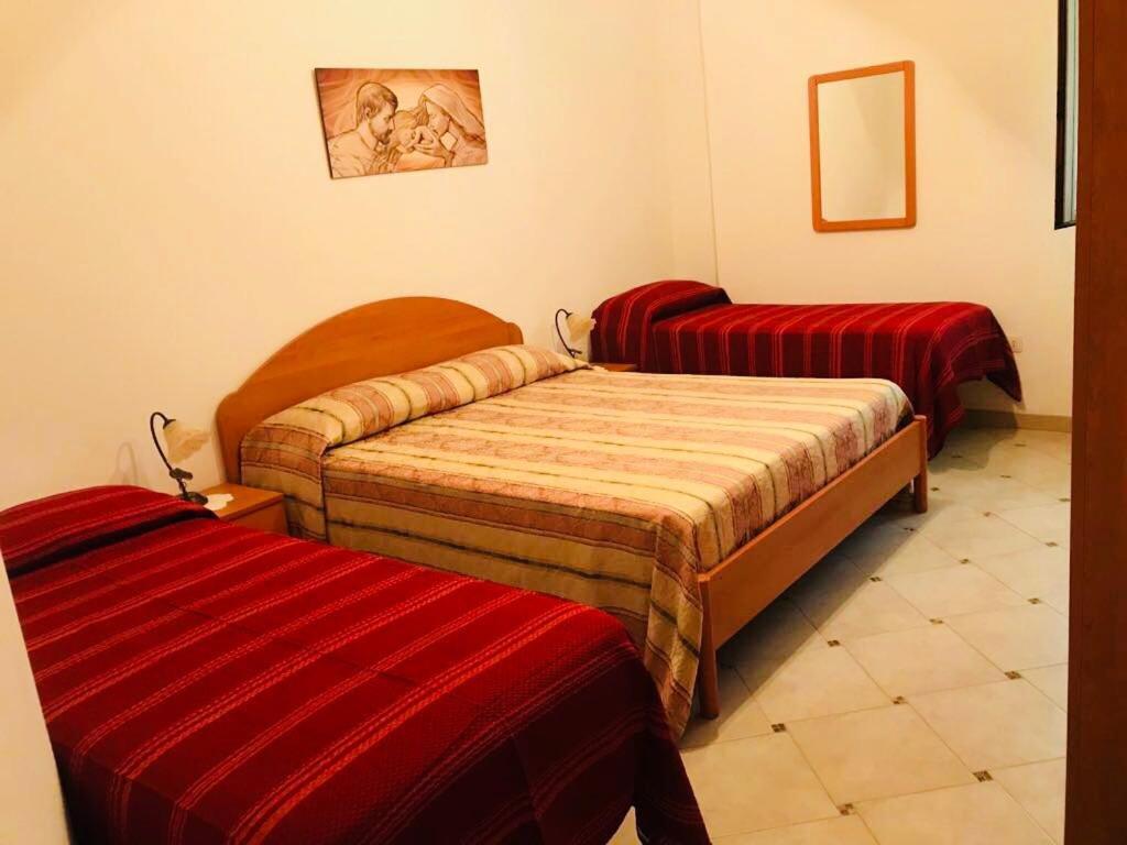 Letto o letti in una camera di Casa in Via Sardegna