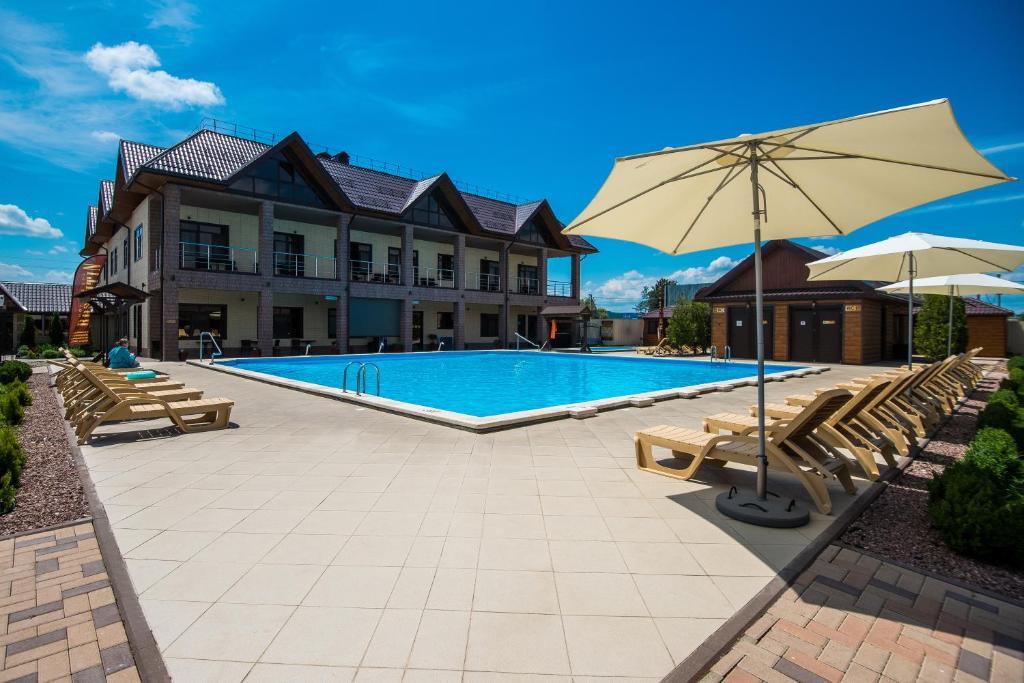 The swimming pool at or near Rasputin Hotel