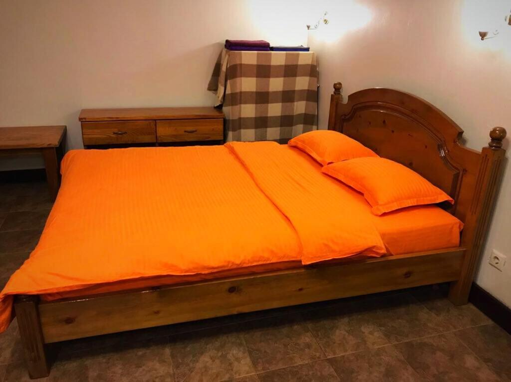 Кровать или кровати в номере Apartment on Kurortny Prospekt