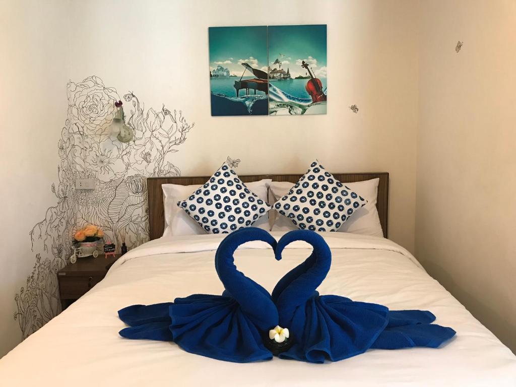 Ein Bett oder Betten in einem Zimmer der Unterkunft Harbor House