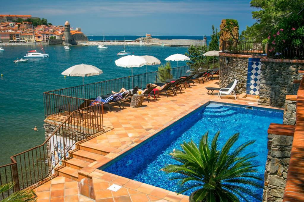A view of the pool at Le Relais Des Trois Mas or nearby