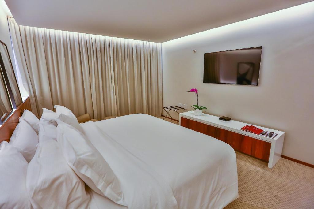 Cama ou camas em um quarto em Castro's Park Hotel