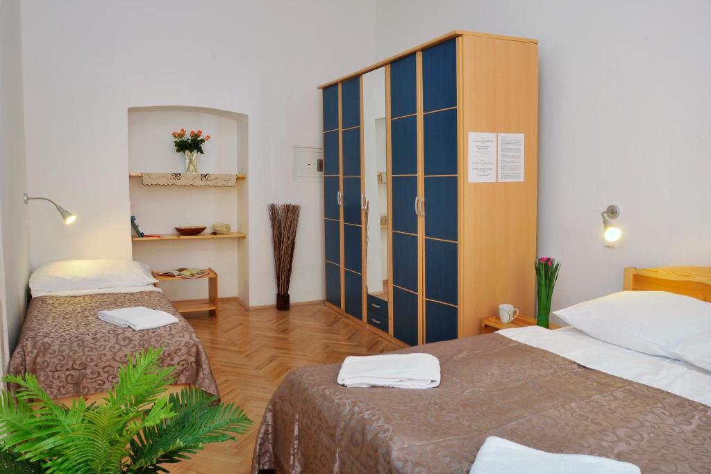 Кровать или кровати в номере Pension Prague City