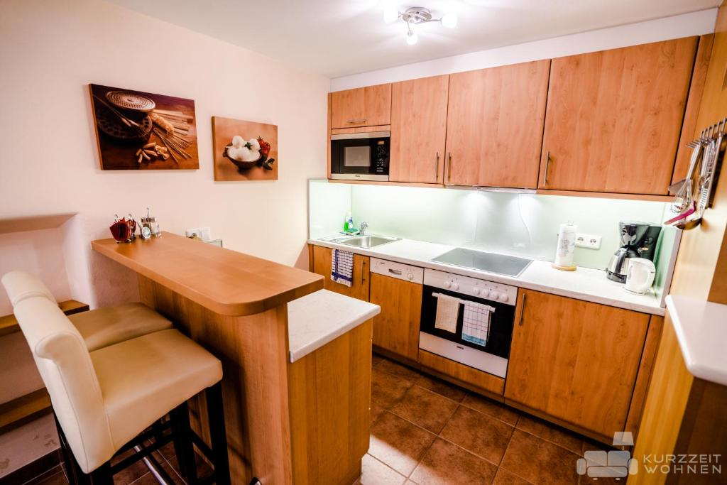 A kitchen or kitchenette at Appartements Steingasse