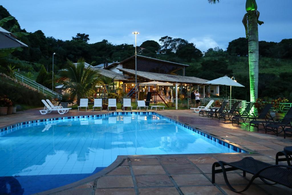 The swimming pool at or near BellaMinas Pousada