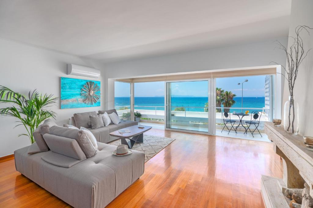 A seating area at Beach Front Beautiful Sea Views Home 120m2