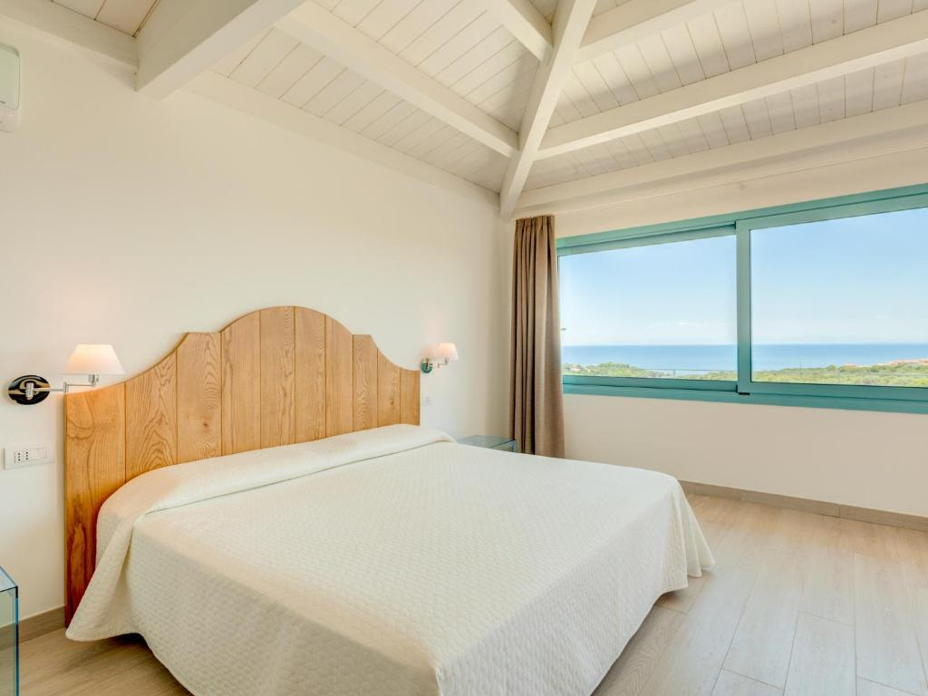 A bed or beds in a room at Park Hotel Asinara
