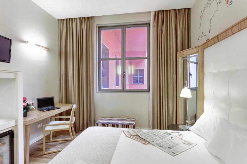 Letto o letti in una camera di Italiana Hotels Milan Rho Fair