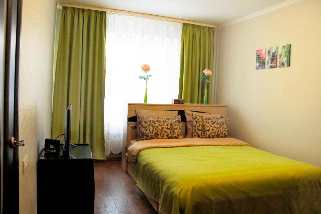Кровать или кровати в номере DearHome Prospect Lenina