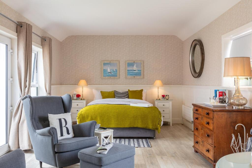 A bed or beds in a room at Roseville House - Luxury Accommodation
